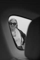 Cabin Fever (waxyleaves) Tags: woman glasses sunglasses strap funnyface whistle blonde outside blackandwhite vape confusion akimbo plump
