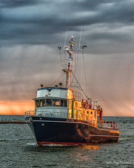 Home Before the Squall (JulieNMansour) Tags: sunset hollandstatepark fishing boat lakemichigan puremichigan