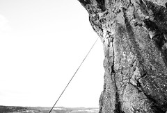 (Mallory Walle) Tags: black white noir blanc noiretblanc blackandwhite bnw countryside campagne aveyron cliff climb escalade falaise friend frere brother portrait rope corde contemplation high hauteur back dos clouds sky nuages ciel selfie