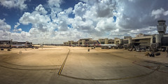 Airports see more sincere kisses than wedding halls... (Just lovin' it) Tags: airport clouds miami airplanes