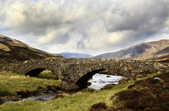 The Old Bridge (maureen bracewell) Tags: highlands scotland hills landscape river spring trees cluniewater glenclunie highlandsofscotland uk bridge packhorsebridge architecture remote stream sky clouds cannon maureenbracewell
