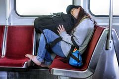 Traveller  /  Voyageuse (H - - J) Tags: subway tube train luggage backpack jeans woman metallic window seat pole red feet shoeless symbol symbolic light gray grey blue