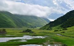 Caucasus 22 (orientalizing) Tags: clouds desktop featured georgia grassy kazbegi kazbegiregion mountains sno swamp valley verdant