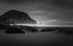 Morro Rock - B&W (byron bauer) Tags: byronbauer rain storm clouds mist fog rock beach sea pacific ocean surf sand dunes texture topaz simplify morrobay california painterly seascape landscape formation outdoor coast water blackwhite