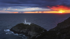 South Stack Lighthouse. Anglesey, Wales (RenaldasUK) Tags: canon6d 247028 wales holyhead anglesey lighthouse sunset sea sky sun clouds blue canon uk seascape