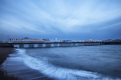 flagging the full moon (sussexscorpio) Tags: moon moonlight fullmoon le longexposure sea seashore beach waves water brighton brightonandhove pebbles clouds sky blue pier palacepier brightonpier shore flags canon canon80d seaside shoreline lights dusk night architecture tones