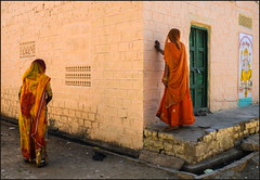Wall.    Jaisalmer (Claire Pismont) Tags: asie asia inde india rajasthan pismont clairepismont colorful couleur color colour woman women ganesha ganesh travel travelphotography streetshot street streetphotography viajar voyage veil orange yellow home