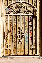 Santa Ana - Rot Iron Door (www.karltonhuberphotography.com) Tags: 2017 alley backdoor citystreets door graffiti ironwork karltonhuber metalwork morninglight orangecountycalifornia rotirondoor rust santaana shadow southerncalifornia streetscene theoc urban urbandecay weathered