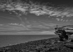 Staring at the sea (markrd5) Tags: wirral hilbreisland seascape rocksandwaterchallenge clouds sky mono nikon1024mm ndgrad leefilters