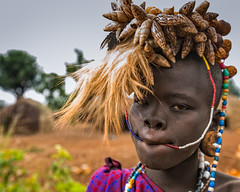 The Mursi Girl (Omo Valley, Ethiopia 2014) (Alex Stoen) Tags: africa african child colors creativelighting culture ethiopia facesofabyssinia girl militiavillage mursi omovalley pocketwizard portrait rural serious tradition travel tribal tribes village context ethnicgroup ethnictribe headornaments headdress nomadic offshoeflash ornaments portraiture seashells status