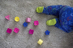 Week 22 - Story: Geometric Shapes (On The Go) (Ben Aerssen) Tags: shapes geometric story colours carpet triangle circle square star rectangle feet baby pajamas green pink purple yellow blue red beige crawling away onthego toys