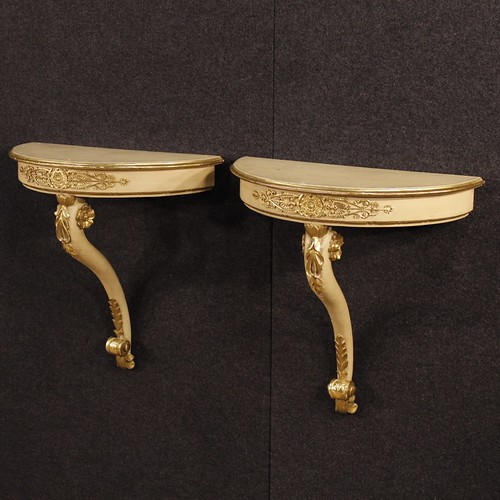 Pair of French lacquered and golden console tables