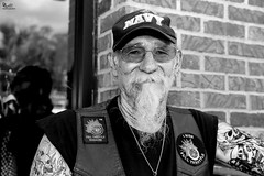 """Not his first rodeo"" IMG_3571 Leesburg, Florida Bikefest 2016 (DanGibsonPhotography) Tags: biker motorcycle harley davidson florida bikefest tattoos male man goatee"
