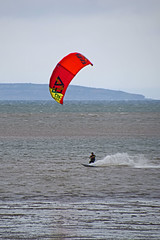 Kite Surfing 6 (Lord Edam) Tags: sea coast coastline beach river sand rocks llandudno conwy clouds waves mountains groyne kite surfing kitesurfing actionsports