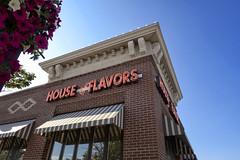 House of Flavors (DJ Wolfman) Tags: houseofflavors ludington ludingtonmi michigan westmichigan blue bluesky brick restaurant petunias olympus olympuspenf penf zuiko 12mmf20 micro43 zd