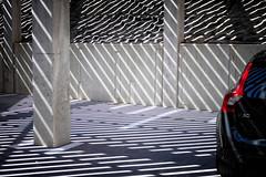 V60 (roberke) Tags: sunlight sunbeams zonlicht zonnestralen beton concrete automobiel auto car red rood garage lijnen ljinenspel lines outdoor