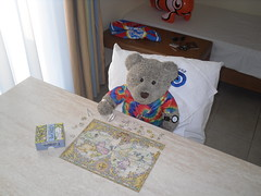 Continuing (pefkosmad) Tags: teenytinypuzzle 300pieces used secondhand missingpieces incomplete tedricstudmuffin teddy bear ted holibobs tedsholibobs holiday vacation vacances pastime leisure hobby pefkos pefki pefkoi rhodes rodos dodecanese hellas greece greekislands griechenland jigsaw puzzle smuggled cute soft toy animal fluffy softie plush world map earth