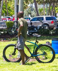 Bald man with bicycle (LarryJay99 ) Tags: florida urban bryantpark intercoastalwaterway palmbeachcounty urbanites candid men man guys dudes lakeworth fourthofjuly smallcity boatraces water people strangers unsuspecting male guy dude hotmenhandsomehunksstuds