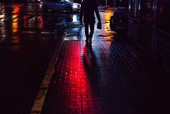 nightcrawler (ewitsoe) Tags: red light sman silhouette write moist wet pavement nikon street urban cityscpae danger lights neon traffic rain autumn man walking shadows groove streets ewitsoe erikwitsoe grain grainy cinematic