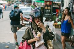 It's fun to take photos of people you doesn't know (przemyslawkrzyszczuk) Tags: thai tajlandia thailand asia azja people woman girl helmet kask bangkok eat glasses street ulica