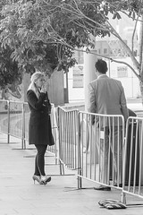 Smoking on the other side (star79322) Tags: steveroebuckphotography sydney scene street smoking blackandwhite blond fence suit fashion shoes seperated opposite chat 2017 coat
