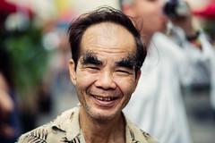 Mr. Tan (Jon Siegel) Tags: nikon d750 zeiss 100mm f2 zeiss100mmf2 man eyebrows master king cool smile portrait portraitsofstrangers singaporean chinese singapore afternoon people kingofalleyebrows
