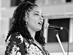 Rajdulari Barnes at the Colorado Black Arts Festival in Denver (forestforthetress) Tags: woman singer song music musician festival outdoor bw blackandwhite denver soulmusic rbmusic jazzmusic coloradoblackartsfestival artinmotion rajdularibarnes rajdulari google flickr face people stage concert gig vocals vocalist monochrome fun entertainment blackculture kuumbastage beauty denvercitypark