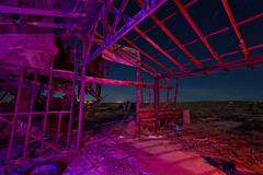 things fall apart. mojave desert, ca. 2015. (eyetwist) Tags: eyetwistkevinballuff eyetwist night abandoned collapsed leaning derelict farmhouse homestead mojavedesert antelopevalley nikon nikond7000 d7000 nikkor capturenx2 1024mmf3545g fullmoon photography desert arid dark longexposure moonlight moonlit tripod npy nocturne highdesert mojave california moon long exposure angle wideangle wide light painting lightpainting roadside america tumbleweeds horizon forgotten ruin decay house shack wood crumbling broken architecture peeling faded weathered roof wall stars startrails northstar urbex alfalfa farm sky clapboard saturated av antelope valley purple red landscape