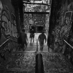 More ghosts in the Graffiti Tunnel (astrogirl969) Tags: fujifilm xe1 samyang12mmf20ncssc sydney sydneyuniversity graffititunnel graffiti tunnel art blackandwhite monochrome postprocessed silverefexpro composite dark longexposure nd8 haidandfilters motionblur wideangle stairs filmsimulation fujifilmneopanacros100 10faves 2000views