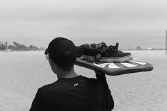 Serving up sneakers (ROSS HONG KONG) Tags: sneakers shoes board serve carry santamonica santamonicabeach california black white bw blackandwhite leica monochrom monochrome blanc noir streetphoto