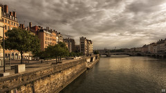 Riverside (BAN - photography) Tags: saoneriver lyon bridge buildings esplanade riverside riverwalk water d810 reflection chimneys cloud