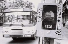 WHISKY (35mm) (jcbkk1956) Tags: bangkok thailand ekkamai street bus streetfurniture mono blackwhite stickers contax 167mt ilford manualfocus 35mm analog carlzeiss 45mmf28 blur motion dof graffiti worldtrekker