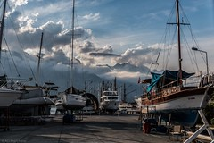 Clouds roll in (Anthony P26) Tags: boat category flickrpost kemer kemermarina landscape places transport travel turkey canon1585mm canon70d canon outdoor mountains taurusmountains clouds sky whiteclouds boats ships masts hull boatyard light shadows