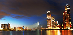 Crossing Erasmus (Robert-Jan van Lotringen) Tags: rotterdam netherlands nightphotography kopvanzuid erasmus bridge water maas lights skyscraper cityscape evening summernight design dusk sundown panorama composition olympus