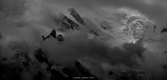 Sentinelle de l'Ombre (Frédéric Fossard) Tags: monochrome noiretblanc grain texture nuages montagne paysage nature glacier montblanc aiguilledumidi alpes hautesavoie massifdumontblanc hautemontagne lumière ombre atmosphère dramatique neige sérac facenord cimes aiguillerocheuse tourmente orage sombre dark brume