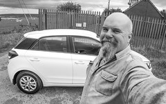 Selfie and the Hyundai 1.2SE i20 2017. (CWhatPhotos) Tags: cwhatphotos mono black white olympus 9mm bodycap lens body cap omd em5 mkii mk ii four thirds view digital camera photographs photograph pics pictures pic picture image images foto fotos photography artistic that have which with contain artistc art light auto automobile car hyundai i20 hyundaii20 12se 12 se vehicle 2017 new bran selfee selfie me denim shit goatee beard blue smile smiles flickr