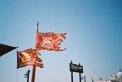 Venice (cranjam) Tags: lomo lca lomography film agfa vista200 italy italia venezia venice unesco worldheritagesite flags bandiere leonedisanmarco leonemarciano leonealato lion leone serviziogondole sign cartello