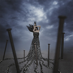 Inside A Cold Embrace (Amani AlShaali) Tags: fineartphotography fineartphotographer amanialshaali conceptual conceptualphotography darkart art fineart sky clouds storm stormyclouds chains chained book cover album albumart bookcover bookart albumcover moody nails stuck emotional trapped