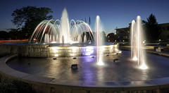 Shelter Fountain (Notley Hawkins) Tags: httpwwwnotleyhawkinscom notleyhawkinsphotography notley notleyhawkins 10thavenue evening bluehour longexposure fountain water reflect reflections 2017 columbiamissouri missouri shelterinsurance night sky clouds ledlights led june