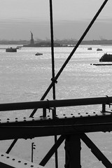 Liberty Island viewed from the Brooklyn bridge (Towner Images) Tags: us usa ny nyc america towner river liberty bridge brooklyn ferry boat libertyisland brooklynbridge eastriver bw mono monochrome monotone monochromatic