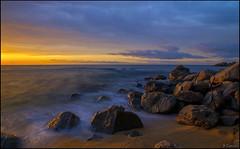 Sol en las rocas. (antoniocamero21) Tags: playa cielo agua rocas amanecer color foto sony caproig girona catalunya paisaje marina nubes mar brava costa