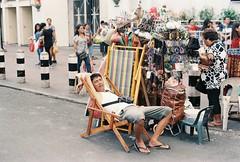 Sleeping While on Duty (Jose Mari Manio) Tags: philippines quiapo manila minolta srt film fujicolor superia street filipino rokkor analog