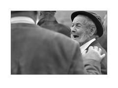 the joke (tirolermichl) Tags: portrait street people bw old blackandwhite bnw fun nikkor nikon grey