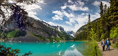 A couple walks around Lake Louise (tibchris) Tags: banff canada alberta lakelouise turquoise lake walk hike promenade mountains sky path couple banffnationalpark 150 travel landscape
