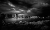 Clash of the Titans (JDS Fine Art Photography) Tags: cityscape skyscape cloudscape ocean water bw monochrome storm clouds sunset twilight dramatic powerful light manvsnature manversusnature clash bestcapturesaoi