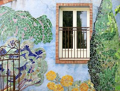 A garden view:  Salernes, Var, Provence (Spencer Means) Tags: dwwg window architecture building wall ceramic tile design art mural flower tree gate iron guard salernes var provence france explore