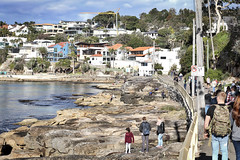 Waterside in winter (geemuses) Tags: manlybeach fairybower shellybeach manly nsw australia landscape sea ocean water rocks path pathway photo photograph woman man scenic scenery waves sun reflection contrast color colour candid street