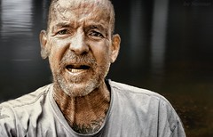 Homeless Man by the Pier (JDS Fine Art Photography) Tags: homeless emotions angst hardship struggle heart compassion touching hurt pain needinghelp street streetphotography streetportrait urban man old wrinkles