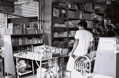Down at the Store (35mm) (jcbkk1956) Tags: bangkok thailand street store thai convenience mono blackwhite contax 167mt film 35mm manualfocus sukhumvitroad thonglo carlzeiss 45mmf28 analog ilford pan100 worldtrekker