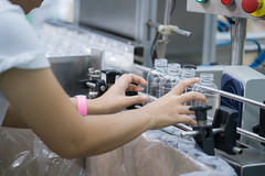 Worker in bottle plastic making working by hand in production line (anekphoto) Tags: production manufacturing plastic bottle water industry bottles line factory plant vodka conveyor white drink bottling beverage blue wrap food process equipment many operator industrial processing work worker job rows mineral woman belt business manufacture monitor recycling facility technology bottled freshness liquid indoors objects glass product qc hand manual speed packing